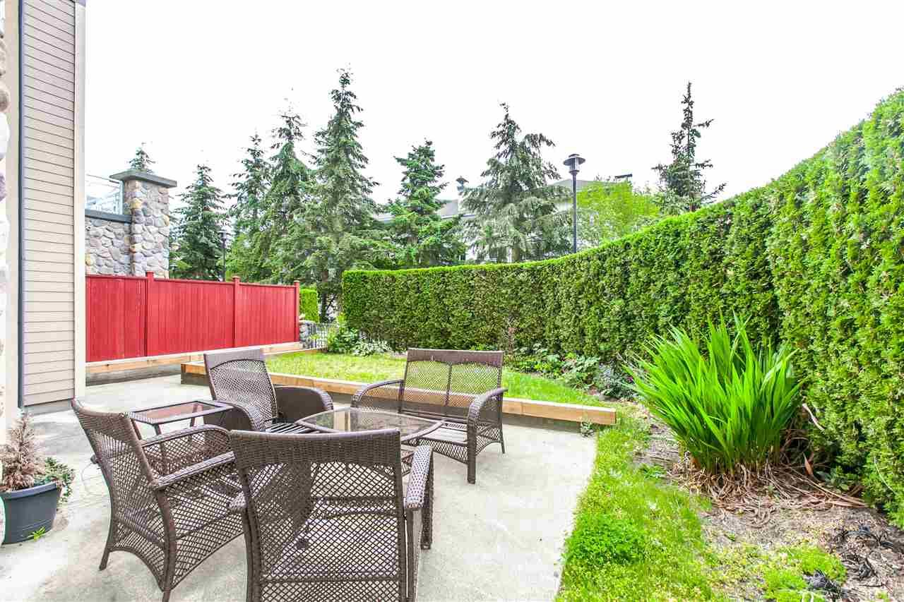 """Photo 2: Photos: 101 3600 WINDCREST Drive in North Vancouver: Roche Point Condo for sale in """"WINDSONG AT RAVEN WOODS"""" : MLS®# R2087149"""