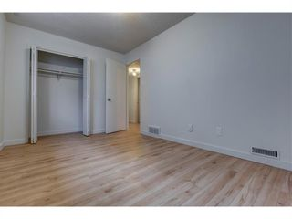 Photo 13: 145 Dovertree Place SE in Calgary: Dover Semi Detached for sale : MLS®# A1090891