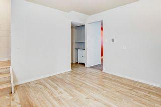 Photo 9: 411 Goddard Avenue NE in Calgary: Greenview Row/Townhouse for sale : MLS®# A1119433