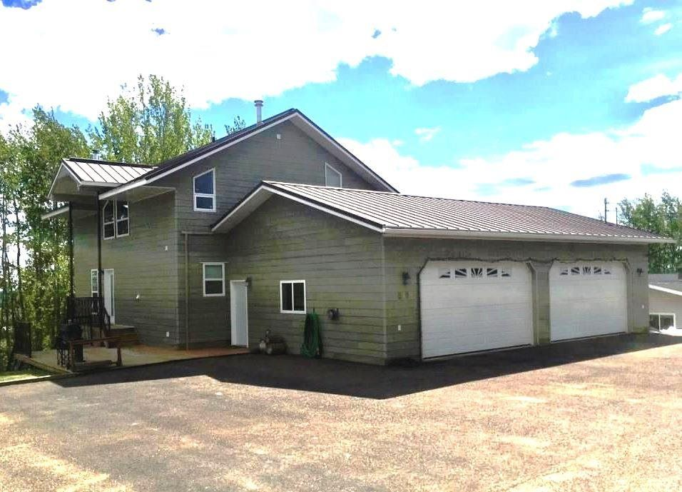 Main Photo: 5408 51 Street in Fort Nelson: Fort Nelson -Town House for sale (Fort Nelson (Zone 64))  : MLS®# R2562111