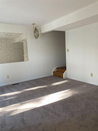 Photo 4: 15 4531 7 Avenue SE in Calgary: Forest Heights Row/Townhouse for sale : MLS®# A1069063
