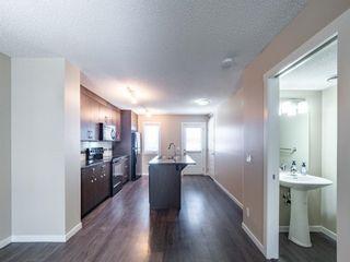 Photo 5: 70 Auburn Bay Link SE in Calgary: Auburn Bay Row/Townhouse for sale : MLS®# A1102367