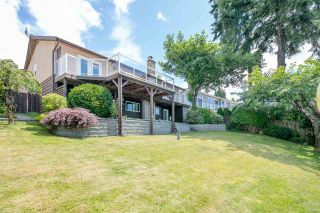 """Photo 1: 7683 GARFIELD Drive in Delta: Nordel House for sale in """"Royal York"""" (N. Delta)  : MLS®# R2477858"""