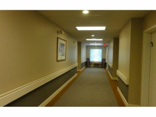 """Photo 12: 128 1653 140TH Street in Surrey: Sunnyside Park Surrey Townhouse for sale in """"Westminster House - Retirement Community"""" (South Surrey White Rock)  : MLS®# F1429181"""