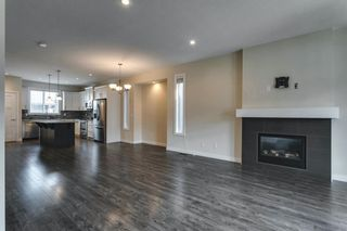 Photo 6: 134 Cooperswood Place SW: Airdrie Semi Detached for sale : MLS®# A1129880