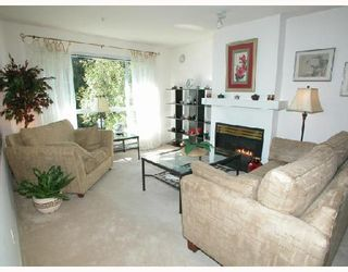 Photo 2: 404 1242 TOWN CENTRE Boulevard in Coquitlam: Canyon Springs Condo for sale : MLS®# V673232