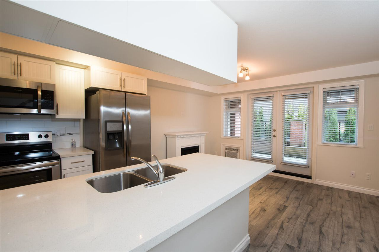 """Photo 2: Photos: 109 5650 201A Street in Langley: Langley City Condo for sale in """"PADDINGTON STATION"""" : MLS®# R2549015"""