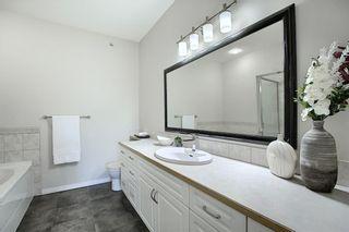 Photo 24: 1410 LAKE FRASER Green SE in Calgary: Lake Bonavista Apartment for sale : MLS®# C4294063