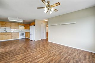 Photo 10: 301 305 1 Avenue NW: Airdrie Apartment for sale : MLS®# A1134588