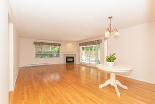 """Photo 2: 111 3670 BANFF Court in North Vancouver: Northlands Condo for sale in """"PARKGATE MANOR"""" : MLS®# R2617167"""