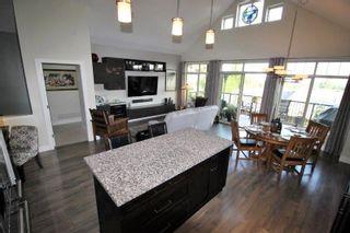 "Photo 2: 109 3467 GISLASON Avenue in Coquitlam: Burke Mountain Townhouse for sale in ""Secret Ridge"" : MLS®# R2401567"