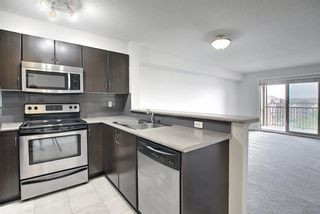 Main Photo: 2423 60 Panatella Street NW in Calgary: Panorama Hills Apartment for sale : MLS®# A1130991