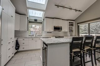 Photo 15: 512 Coach Grove Road SW in Calgary: Coach Hill Detached for sale : MLS®# A1127138