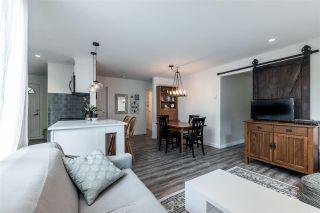 Photo 1: 203 9130 CAPELLA Drive in Burnaby: Simon Fraser Hills Condo for sale (Burnaby North)  : MLS®# R2408059