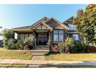 Photo 1: 15071 76A Avenue in Surrey: East Newton House for sale : MLS®# F1421243