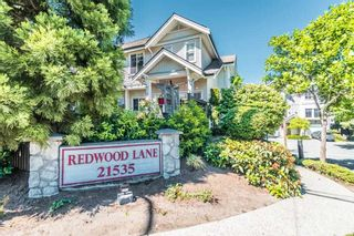 """Photo 1: 12 21535 88TH Avenue in Langley: Walnut Grove Townhouse for sale in """"Redwood Lane"""" : MLS®# R2586469"""