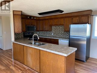 Photo 2: 253080A and 253080B RGE RD 182 in Rural Wheatland County: House for sale : MLS®# A1107960