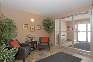 Photo 7: 1202 92 Crystal Shores Road: Okotoks Apartment for sale : MLS®# A1027921