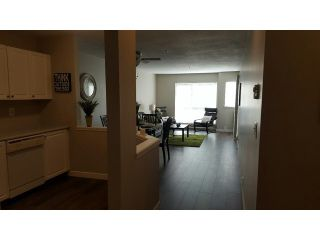 "Photo 6: 204 5499 203RD Street in Langley: Langley City Condo for sale in ""PIONEER PLACE"" : MLS®# F1448758"