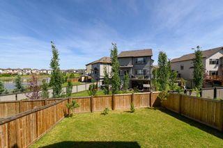 Photo 31: 711 179 Street in Edmonton: Zone 56 House for sale : MLS®# E4257489