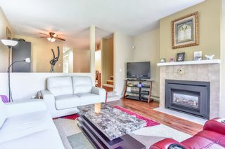 """Photo 2: 104 12233 92 Avenue in Surrey: Queen Mary Park Surrey Townhouse for sale in """"Orchard Lake"""" : MLS®# R2565591"""