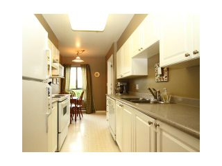 "Photo 1: 310 223 MOUNTAIN Highway in North Vancouver: Lynnmour Condo for sale in ""MOUNTAIN VIEW VILLAGE"" : MLS®# V844629"