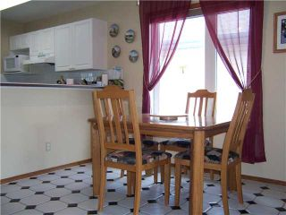 Photo 9: 52 SUNRIDGE Place NW: Airdrie Residential Detached Single Family for sale : MLS®# C3529637