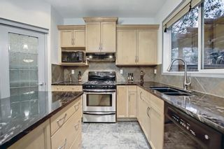 Photo 14: 163 Springbluff Heights SW in Calgary: Springbank Hill Detached for sale : MLS®# A1153228