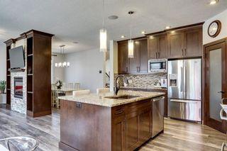Photo 7: 83 ASPEN STONE Manor SW in Calgary: Aspen Woods Detached for sale : MLS®# C4259522