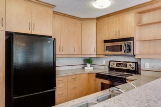 Photo 7: 2121 20 COACHWAY Road SW in Calgary: Coach Hill Apartment for sale : MLS®# C4209212