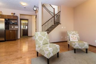 Photo 5: 30 WEST POINTE Manor: Cochrane House for sale : MLS®# C4150247
