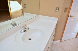 Photo 34: 303 GLENEAGLES View: Cochrane House for sale : MLS®# C4130061