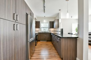 """Photo 12: 217 20219 54A Avenue in Langley: Langley City Condo for sale in """"SUEDE"""" : MLS®# R2449057"""