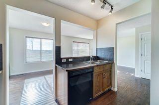 Photo 12: 4 136 Bow Ridge Drive: Cochrane Row/Townhouse for sale : MLS®# A1116097