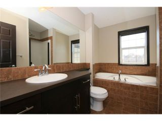 Photo 20: 81 SUNSET Heights: Cochrane House for sale : MLS®# C4072364