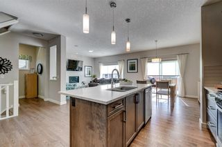 Photo 10: 129 HEARTLAND Way: Cochrane House for sale : MLS®# C4170251