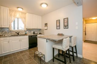 """Photo 7: 404 2733 ATLIN Place in Coquitlam: Coquitlam East Condo for sale in """"ATLIN COURT"""" : MLS®# R2232992"""