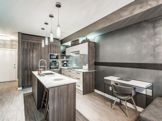 Photo 2: 314 119 19 Street NW in Calgary: West Hillhurst Apartment for sale : MLS®# A1077874