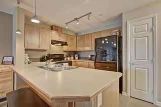 Photo 3: 2108 92 Crystal Shores Road: Okotoks Apartment for sale : MLS®# A1068226