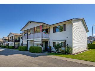 "Photo 1: 36 7455 HURON Street in Sardis: Sardis West Vedder Rd Townhouse for sale in ""Ascott Estates"" : MLS®# R2580749"