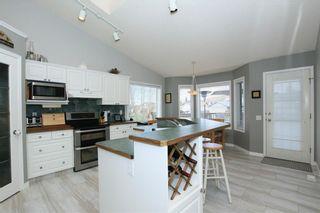 Photo 12: 306 WEST TERRACE Place: Cochrane House for sale : MLS®# C4117766