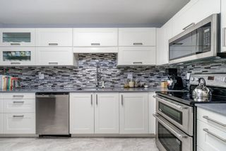 """Photo 9: 101 19121 FORD Road in Pitt Meadows: Central Meadows Condo for sale in """"EDGEFORD MANOR"""" : MLS®# R2380181"""