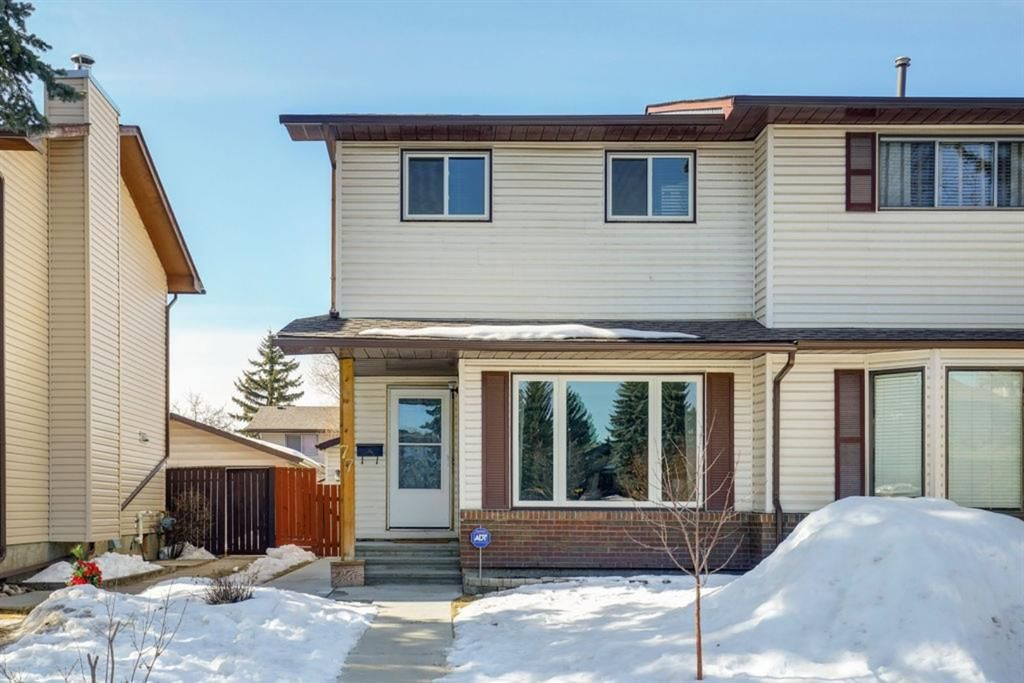 Main Photo: 77 Cedardale Crescent SW in Calgary: Cedarbrae Semi Detached for sale : MLS®# A1076205