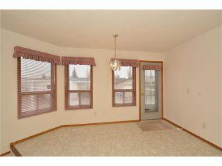 Photo 8: 12 WEST COPITHORNE Place: Cochrane House for sale : MLS®# C4049219
