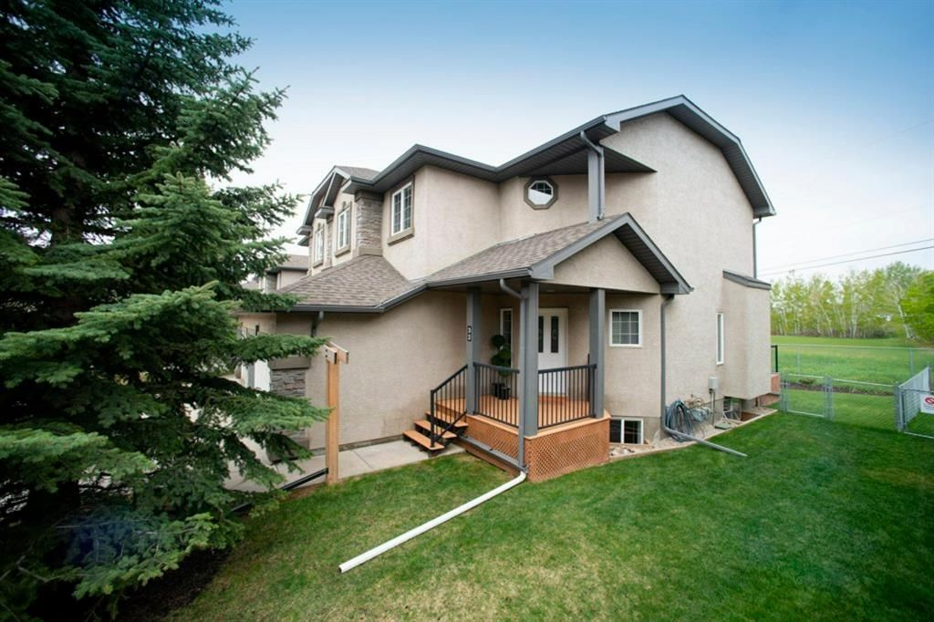 Photo 2: Photos: 32 Prominence Park SW in Calgary: Patterson Row/Townhouse for sale : MLS®# A1112438