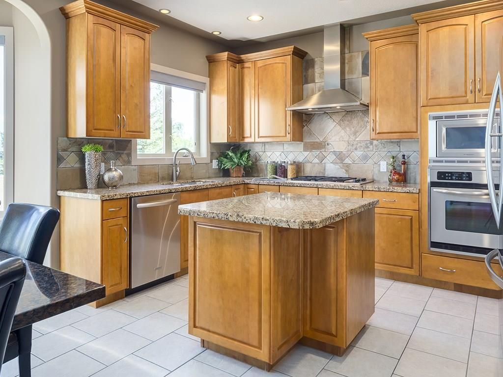 Photo 4: Photos: 1041 PANORAMA HILLS Landing NW in Calgary: Panorama Hills House for sale : MLS®# C4122124
