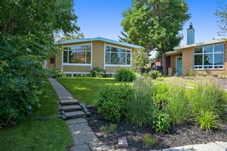 Main Photo: 33 Kentish Drive SW in Calgary: Kingsland Duplex for sale : MLS®# A1137566