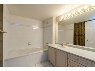 """Photo 13: 107 20120 56 Avenue in Langley: Langley City Condo for sale in """"Blackberry Lane 1"""" : MLS®# R2495624"""
