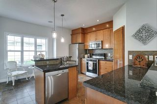 Photo 11: 2965 Peacekeepers Way SW in Calgary: Garrison Green Row/Townhouse for sale : MLS®# A1135456