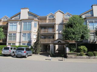 """Photo 1: 405 19131 FORD Road in Pitt Meadows: Central Meadows Condo for sale in """"WOODFORD MANOR"""" : MLS®# R2123164"""